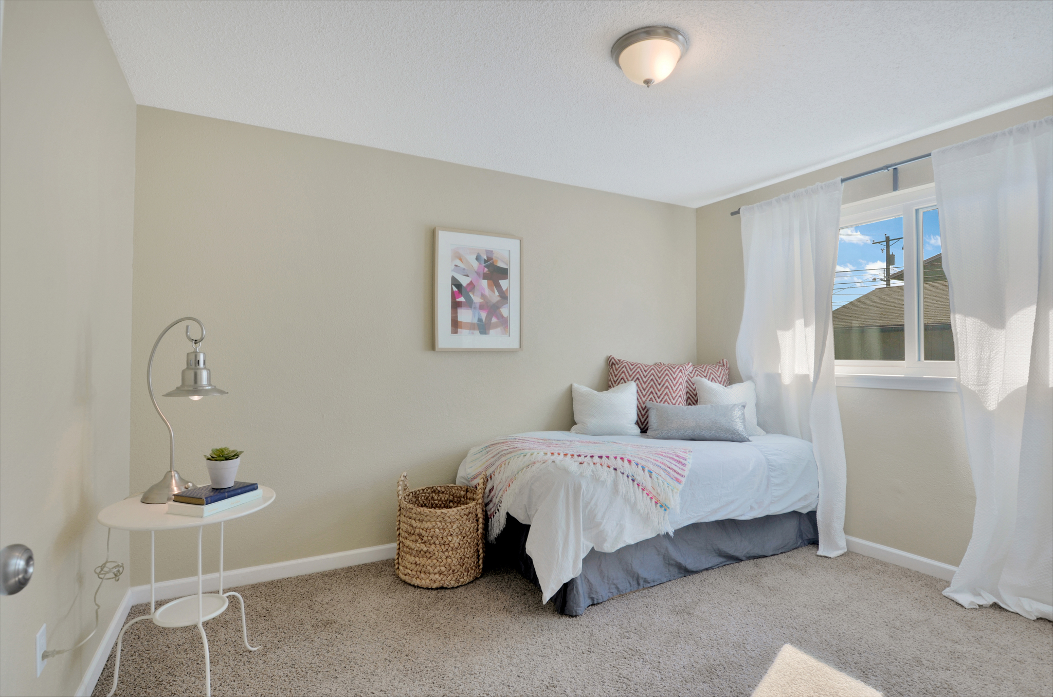 Find 2 additional bedrooms off the hallway with easy access to a full bathroom. Comfortable and carpeted these bedrooms overlook the side yard and are perfect for kids, housemates, or guests.
