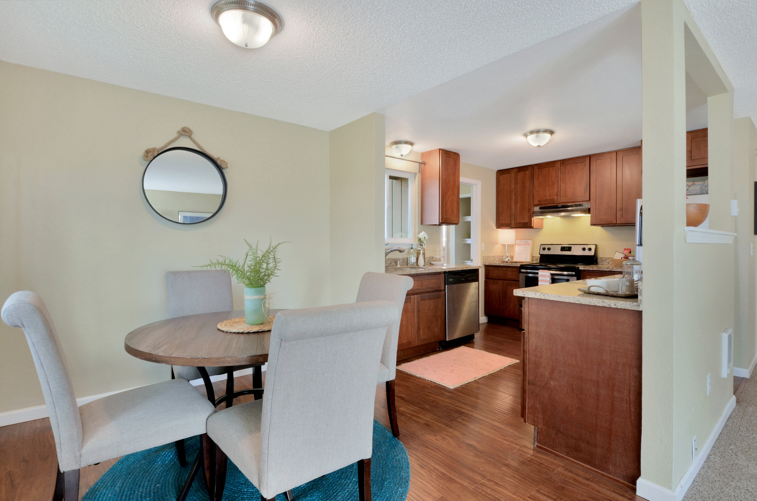 Dining and kitchen are pleasantly connected for cozy, casual meals. You'll notice an opening out into the laundry and pantry area just past the dishwasher.