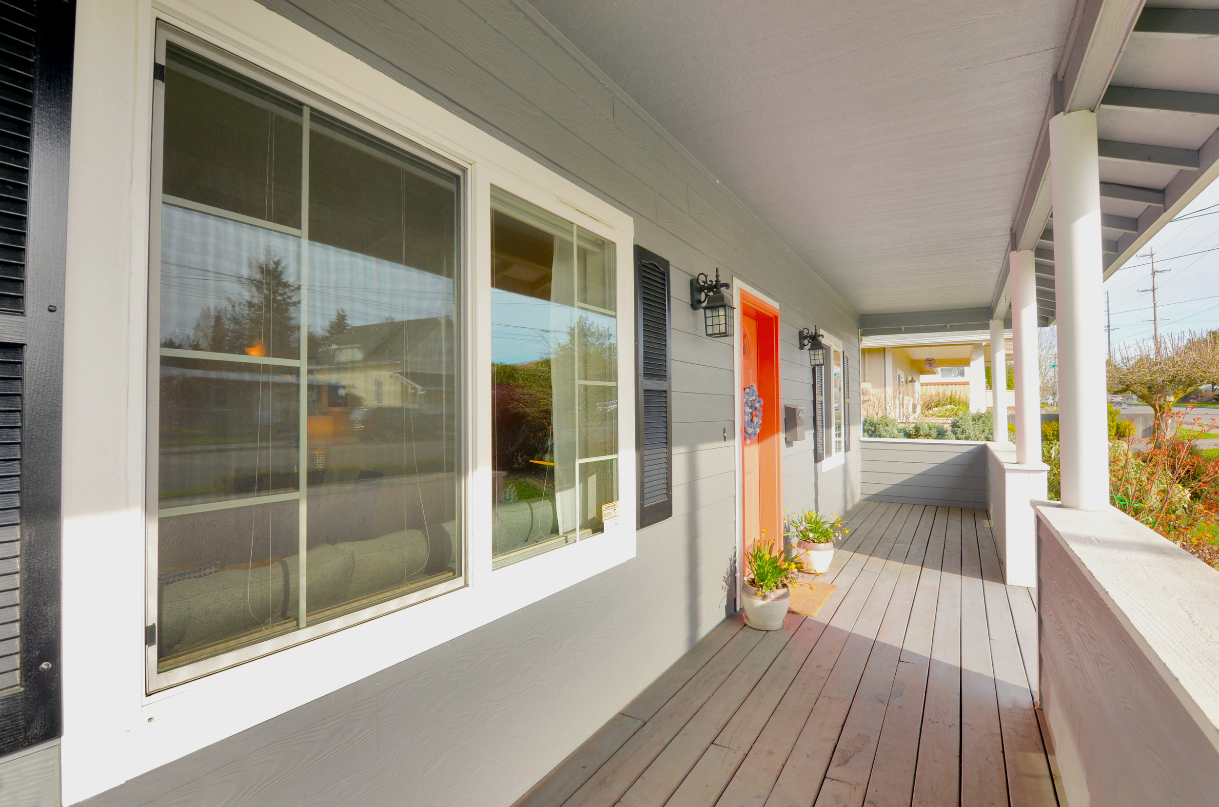 This bungalow front porch offers you a place to shake off the rain, or set up a porch swing.
