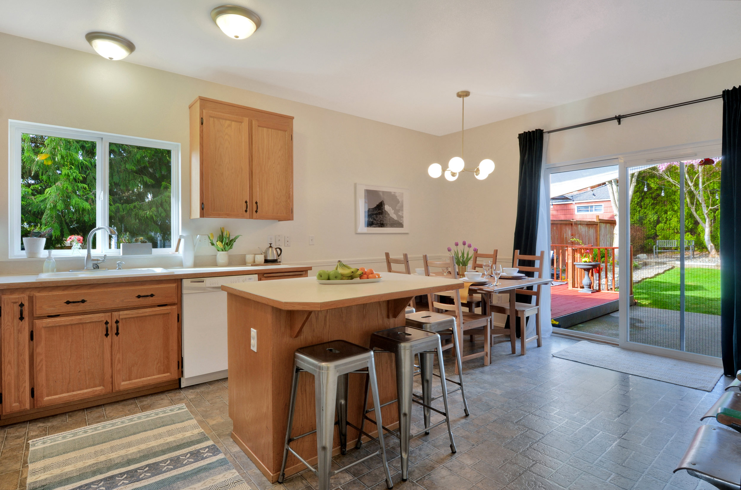 This spacious eat-in kitchen is one of the favorite features of the homeowners. They host 15 for holiday dinners and love the light coming in through the big sliding glass doors.