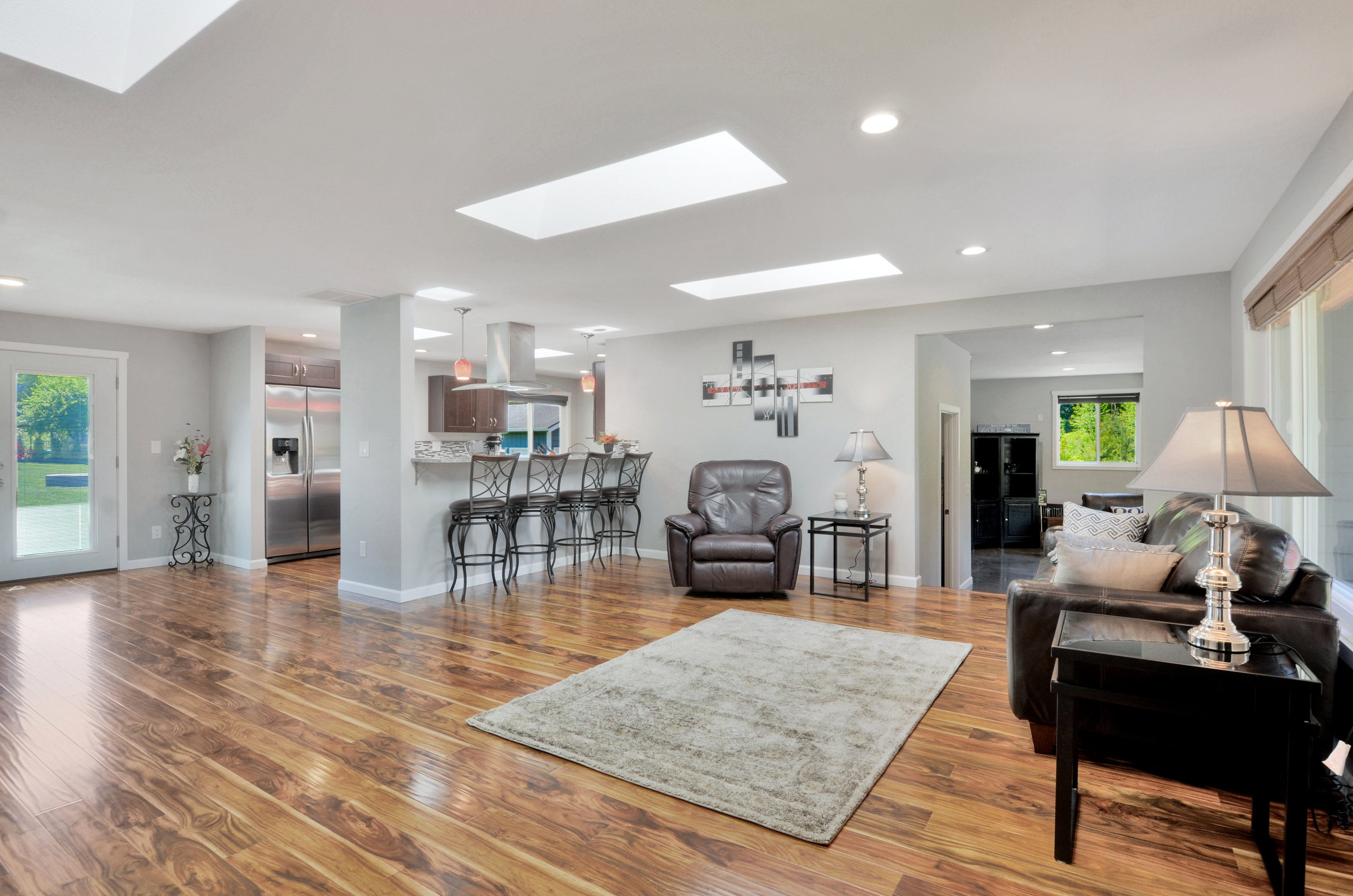 "3 skylights brighten the open living space (2 more in the kitchen!) with its 3/8"" acacia engineered hardwood floors with new pad, smooth coat ceilings, all new windows and wooden blinds, new recessed LED lighting."