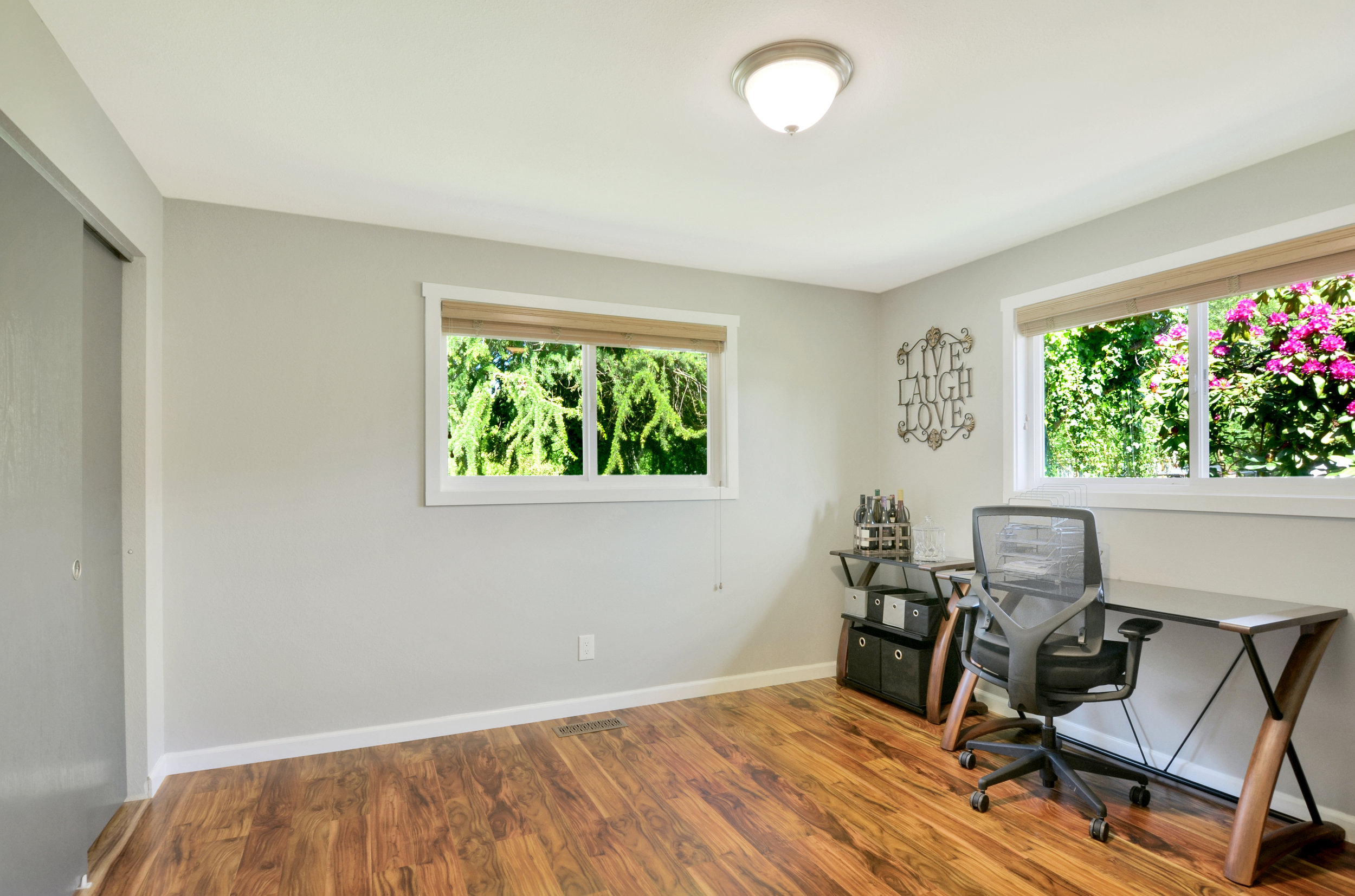 The 3rd bedroom with its big closet and engineered hardwood floor is also a great room to set up as an office, studio, den, playroom or guest room.