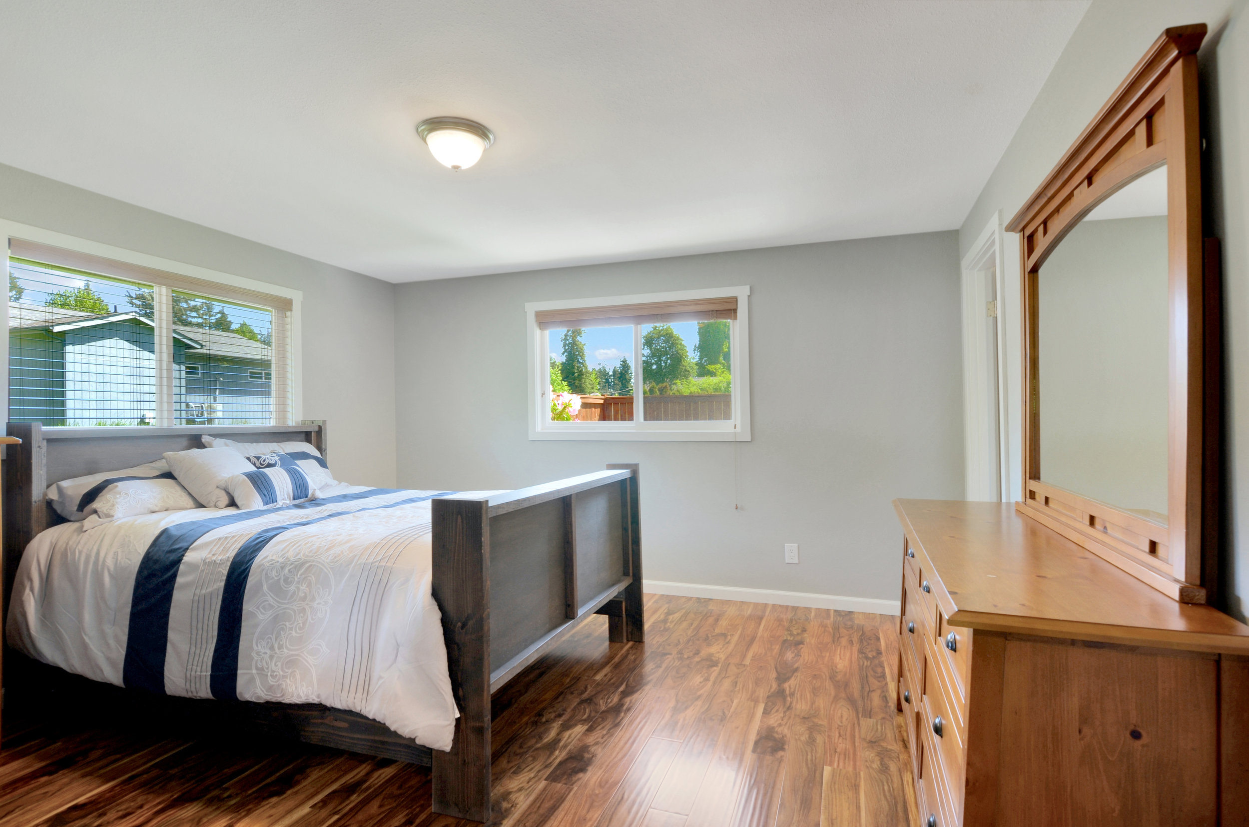 The homeowners considered adding French doors from this bedroom to go straight out to the area where a hot tub could be installed.