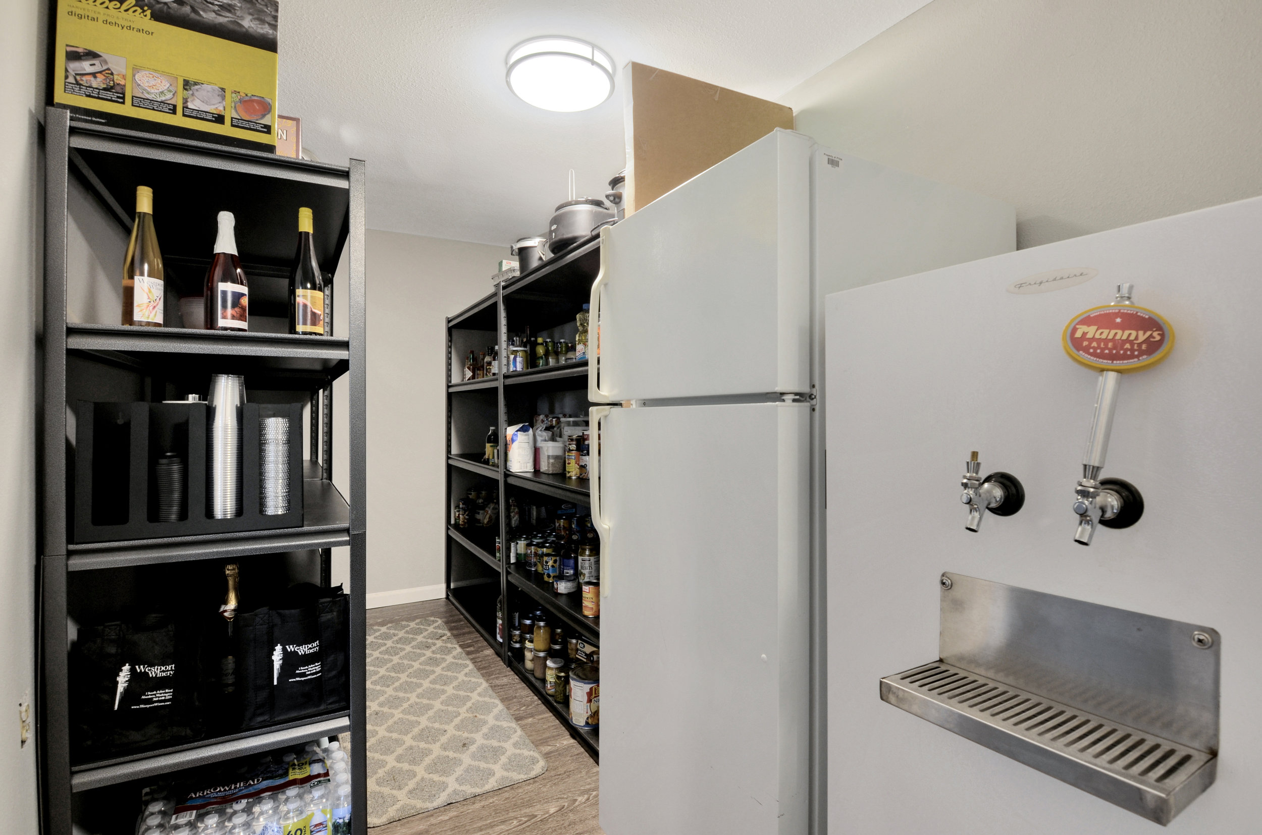 Don't miss the huge pantry accessed from the kitchen, with steps down into the family room as well for a circular flow. Storage galore here in this area, with a big closet just off the kitchen for additional pantry storage.