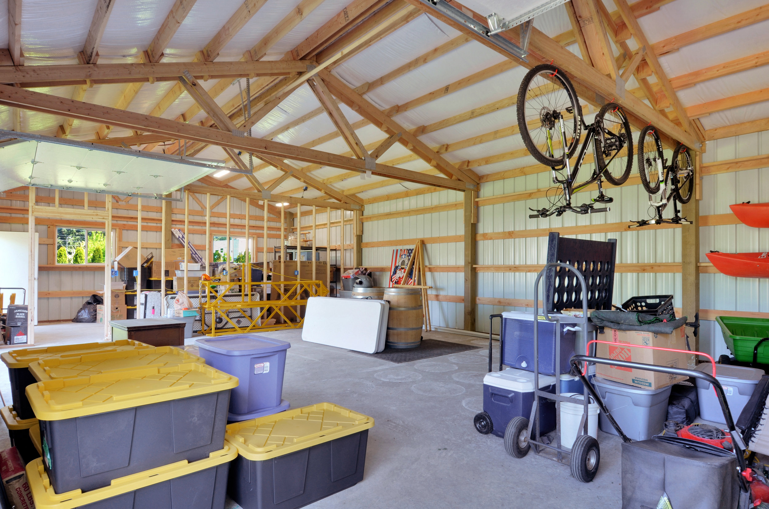 A glimpse at the interior of the newly built workshop. Lots of space for boats, bikes, vehicles, and tools.
