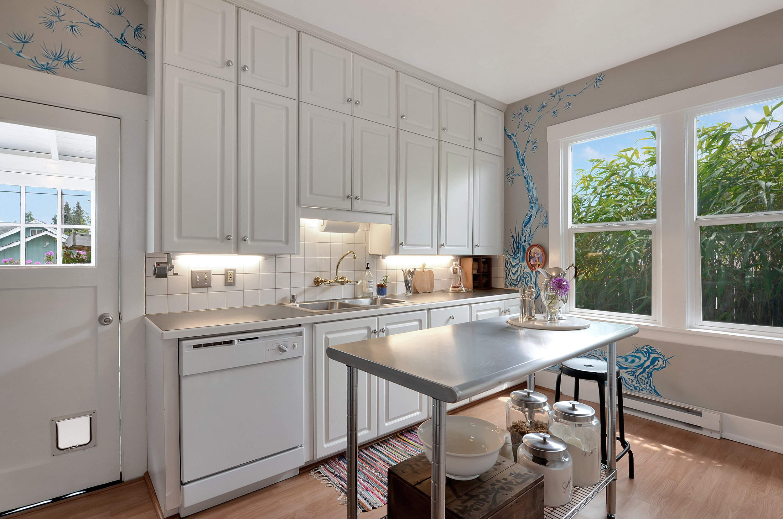 The kitchen leads into the enclosed back porch where the laundry is conveniently located. Also connected to the kitchen are the downstairs bedroom/office and the front living room.