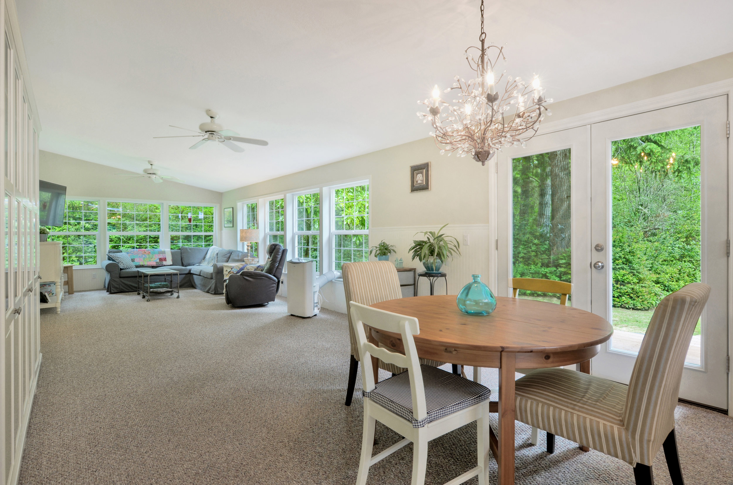 The main living space is comfortable and open. Set up a dining table with leaves so you can extend into this long room for parties or big family meals.