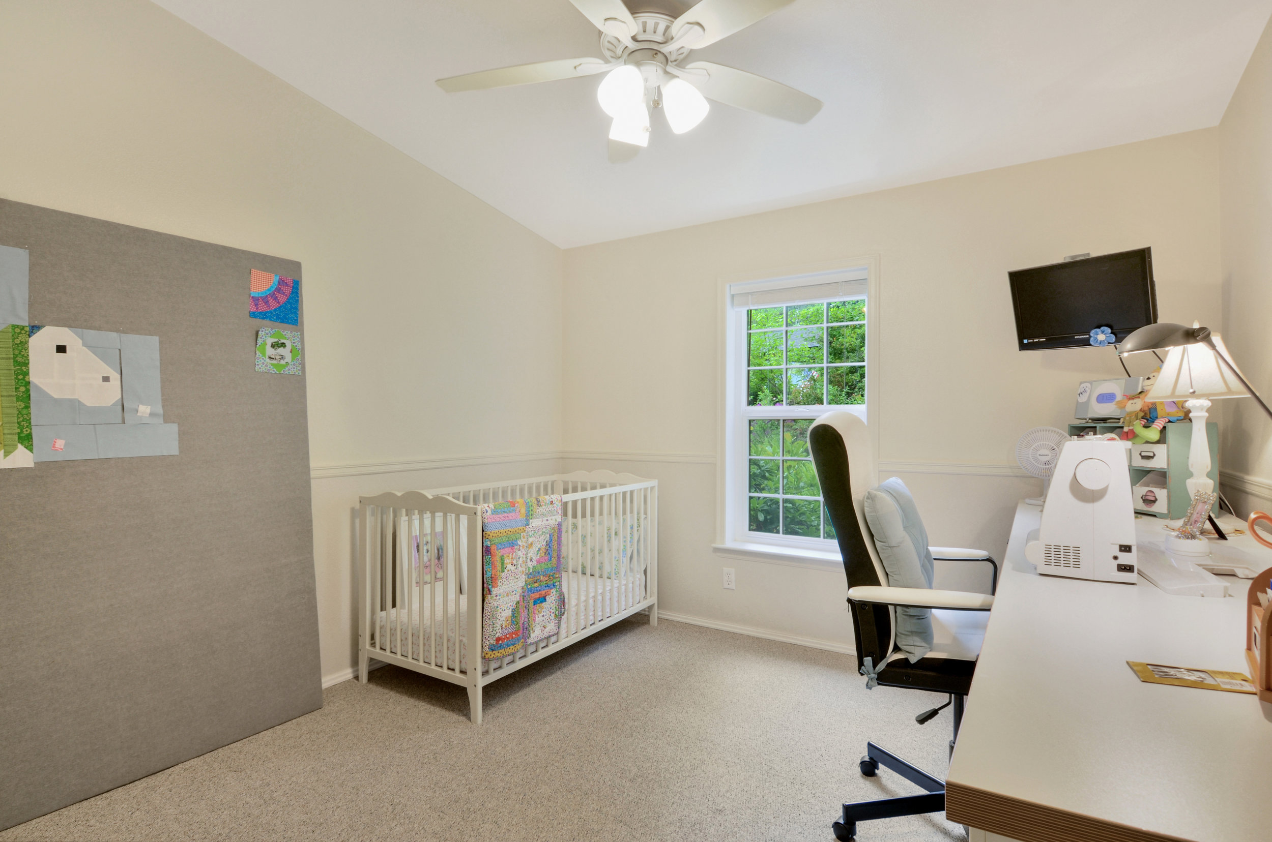 The 3rd of the three bedrooms, this one is set up as a nursery and sewing room. You can use it as a regular bedroom, craft room, guest room, or office depending on the needs and size of your family.