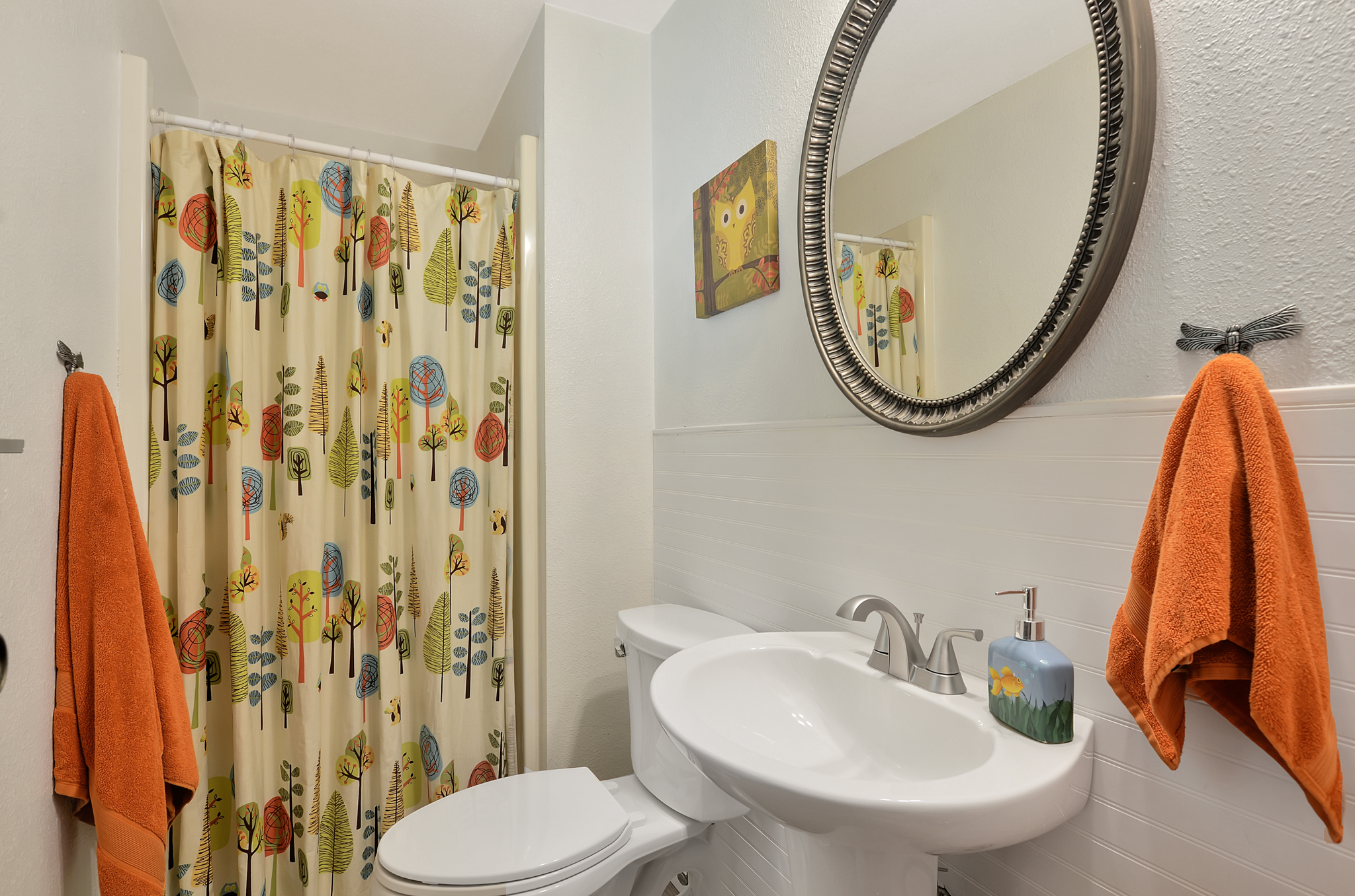 The private 3/4 bath is all set with bamboo flooring, a new toilet, and new pedestal sink. The clean white color scheme invites you to bring your own style and color to the room. You can make it pop with bold and friendly colors, choose soft florals, or neutrals. Anything goes!