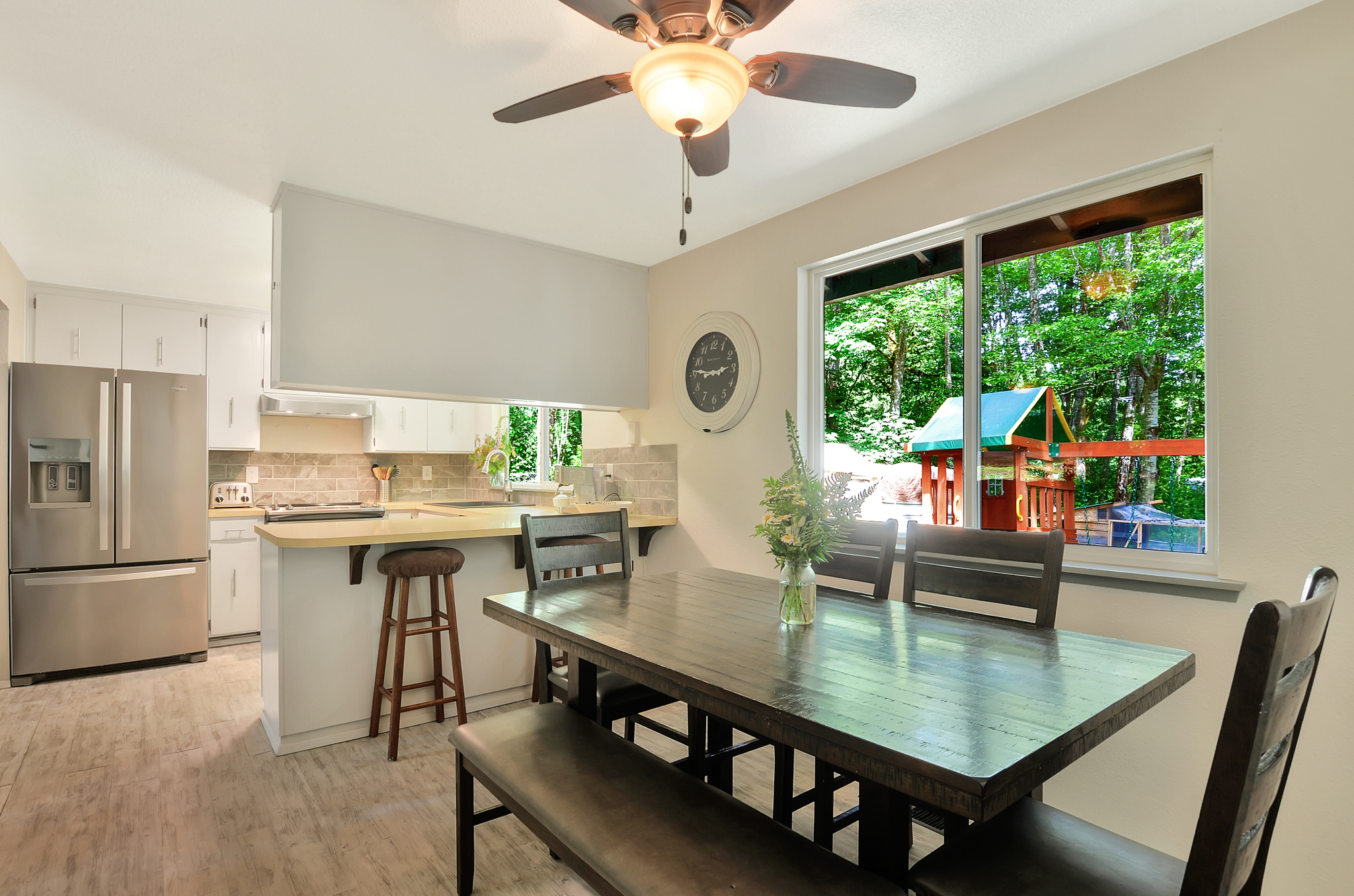 One of our favorite parts of the house is this updated kitchen with the dining room overlooking the back yard.