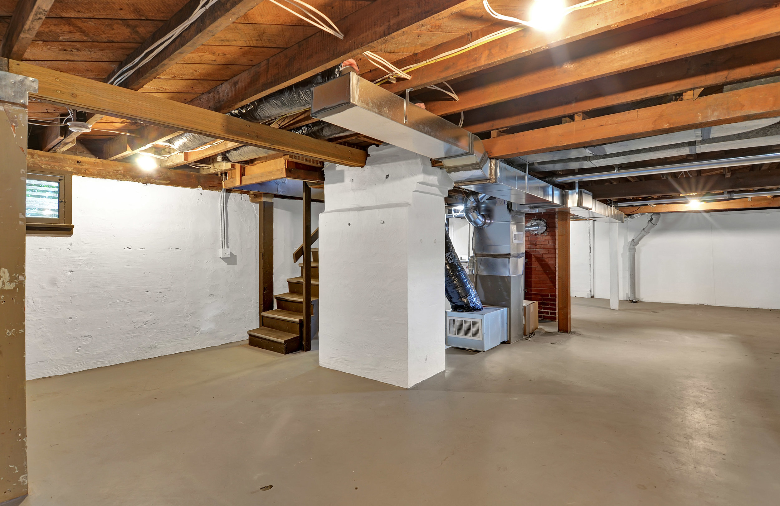 The basement is spacious and clean. This is 924 square feet of unfinished space with a carriage door that opens to the fenced back yard. So think about how you'll use it! There's opportunity for organized storage, workshop space, or even for finishing for additional living space down here.
