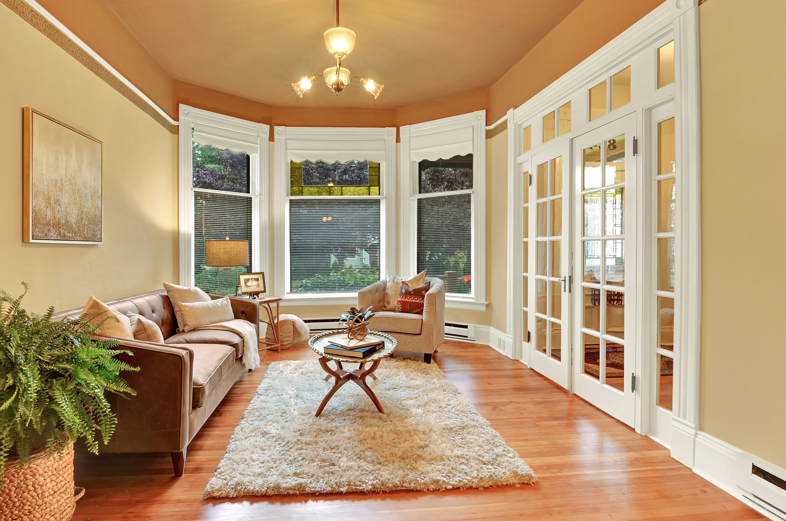 Stained glass panels enrich the bay windows. All windows in the home are protected by storm windows, which helps with heat efficiency.