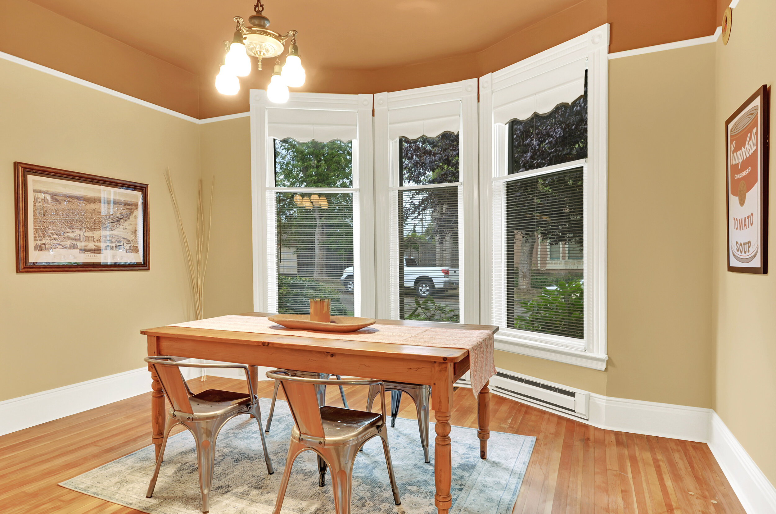 North facing bay windows in the dining room bring in afternoon light.