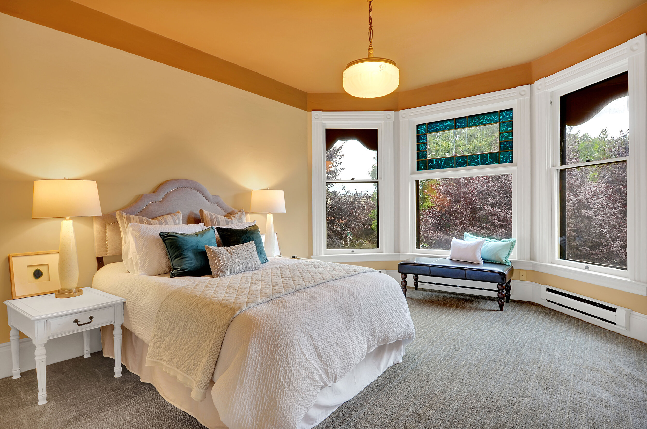 This front, east facing room features bay windows with colored glass, and its own sitting room or dressing room.
