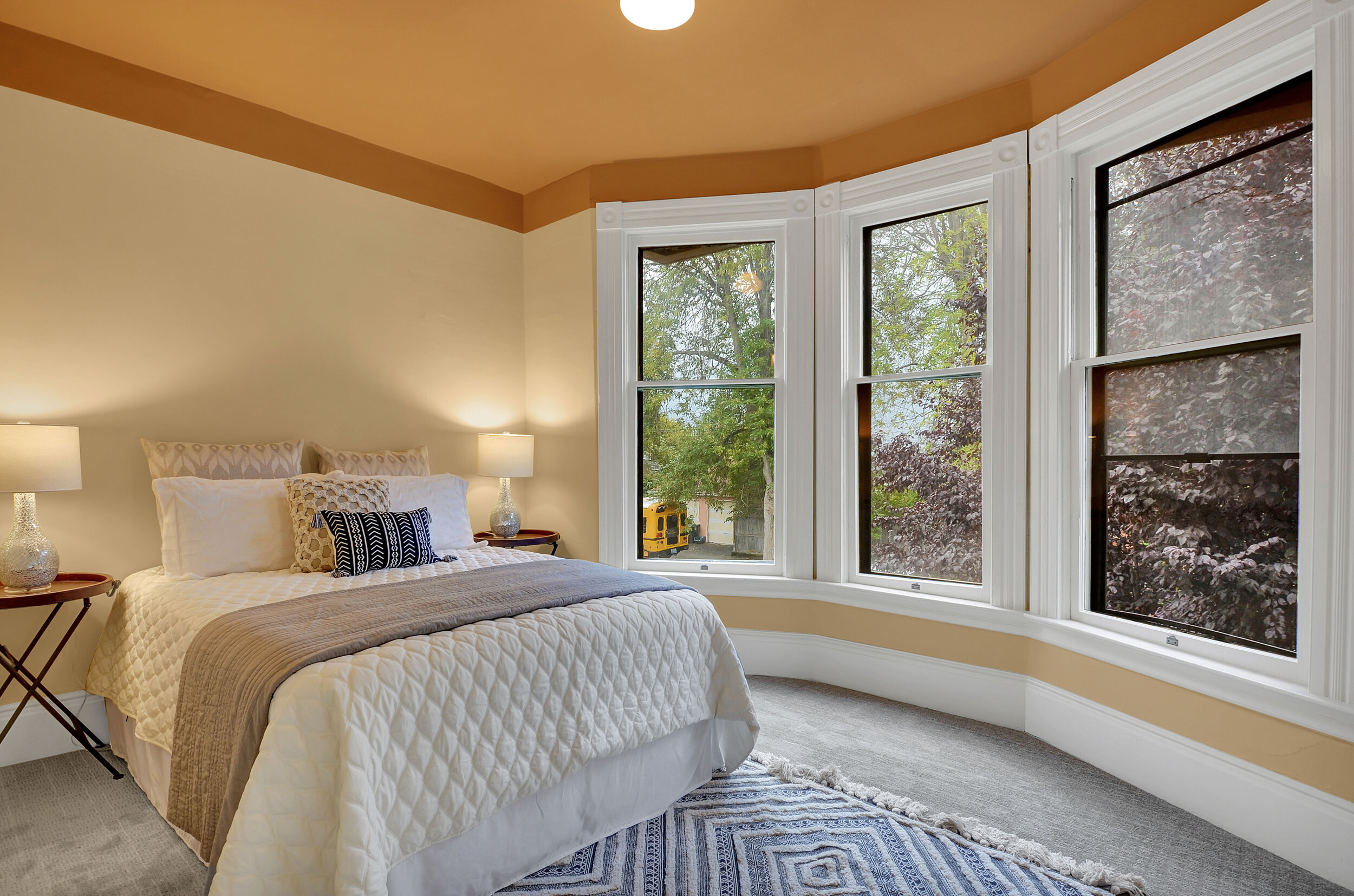 The north bedroom is beautifully lit with bay windows overlooking N 9th St, just like in the dining room below.
