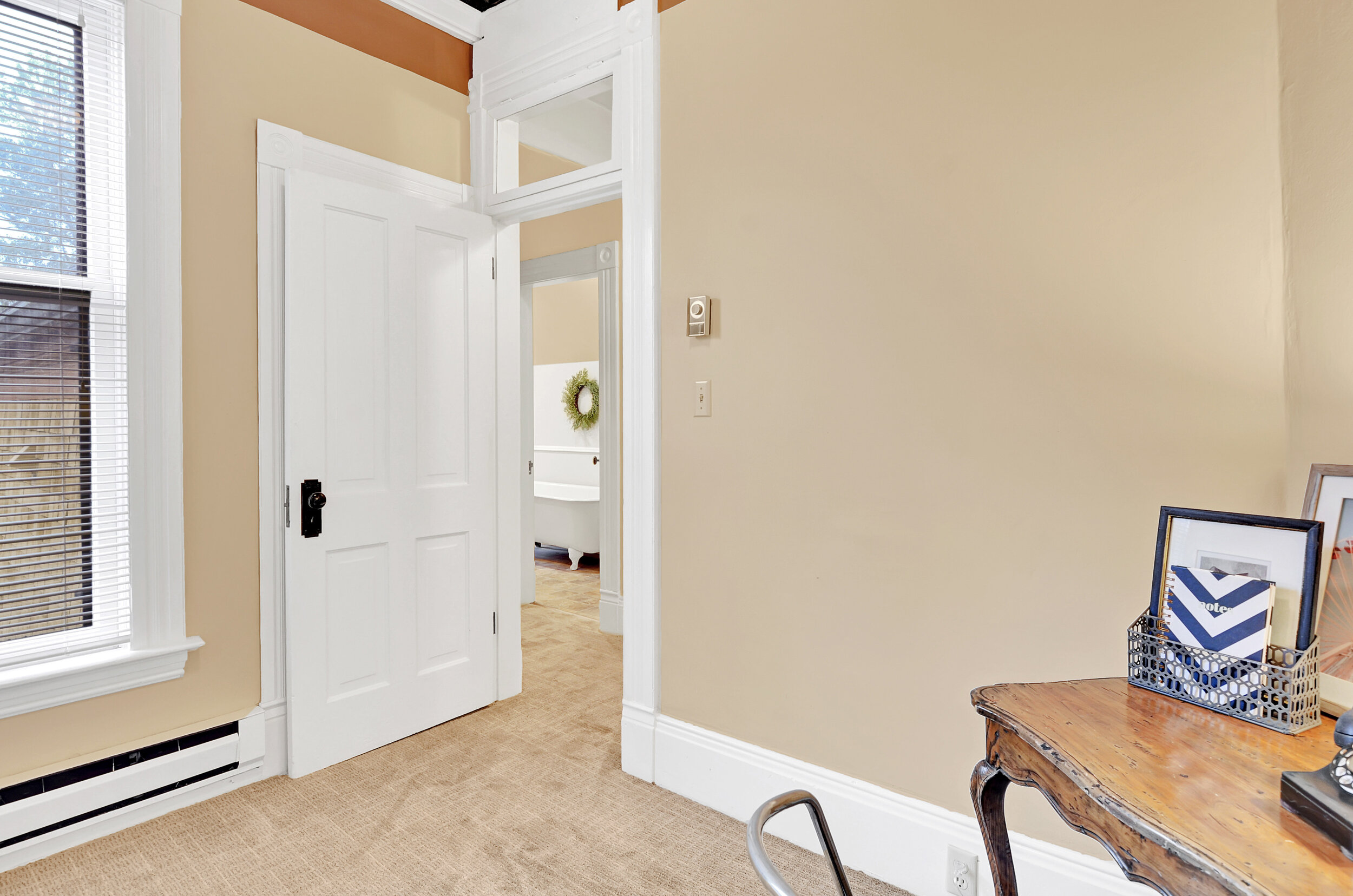 A third smaller bedroom is just across the hall from the bathroom. Here you'll find the access to the attic.