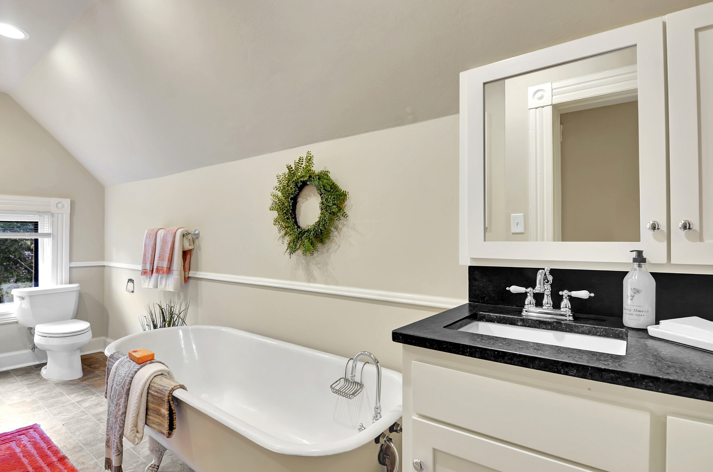 With both a shower and the original 6 foot clawfoot tub, this room has all you need.