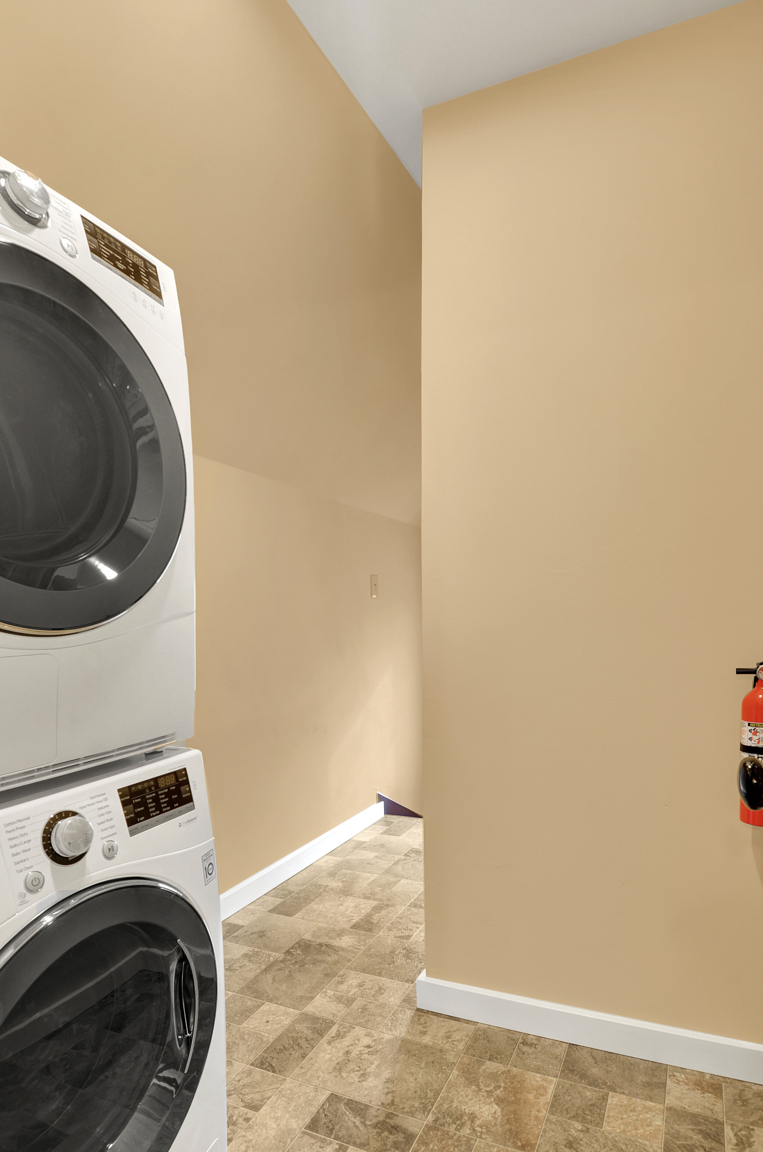 Stackable washer and dryer on the 2nd floor. Good quality, space efficient, front loading machines.