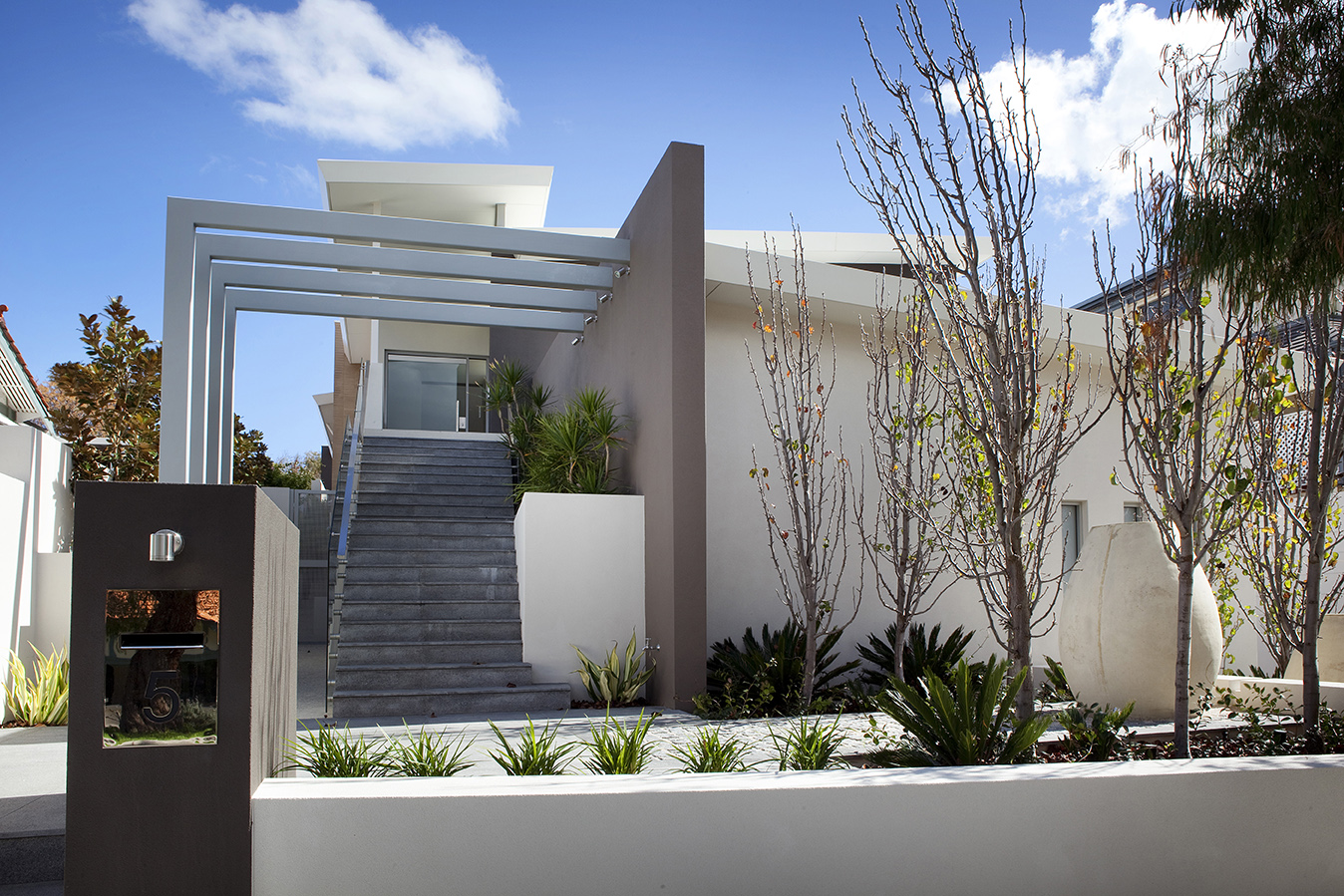 The crisp new front entry to the Cottesloe residence 10 years ago. New landscaping breaking up the new architecture.