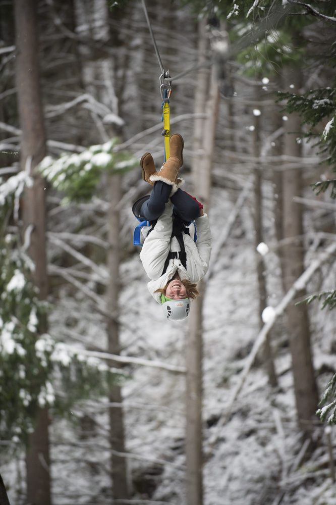Ziptrek Queenstown girl zipping upside down through snow.jpg