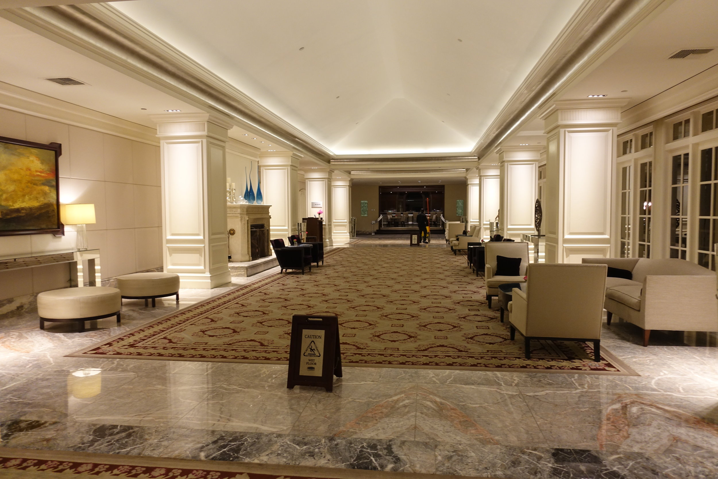 Long hallway leading to dining and rooms