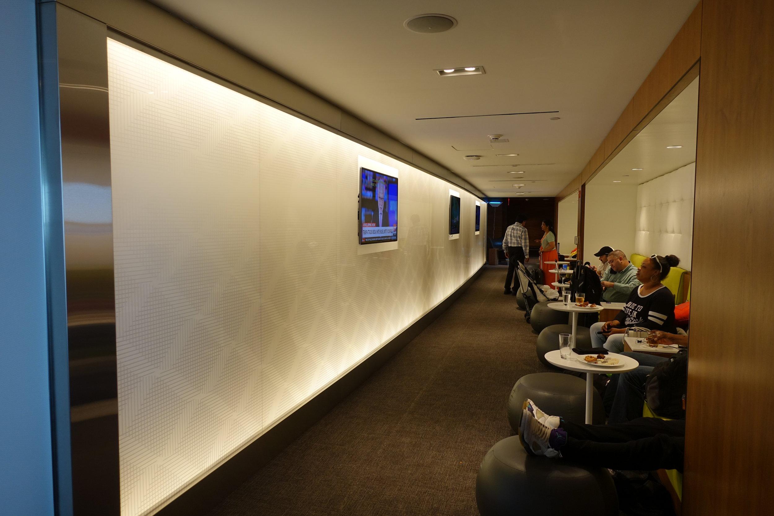 Corridor w/ semi-private workspaces