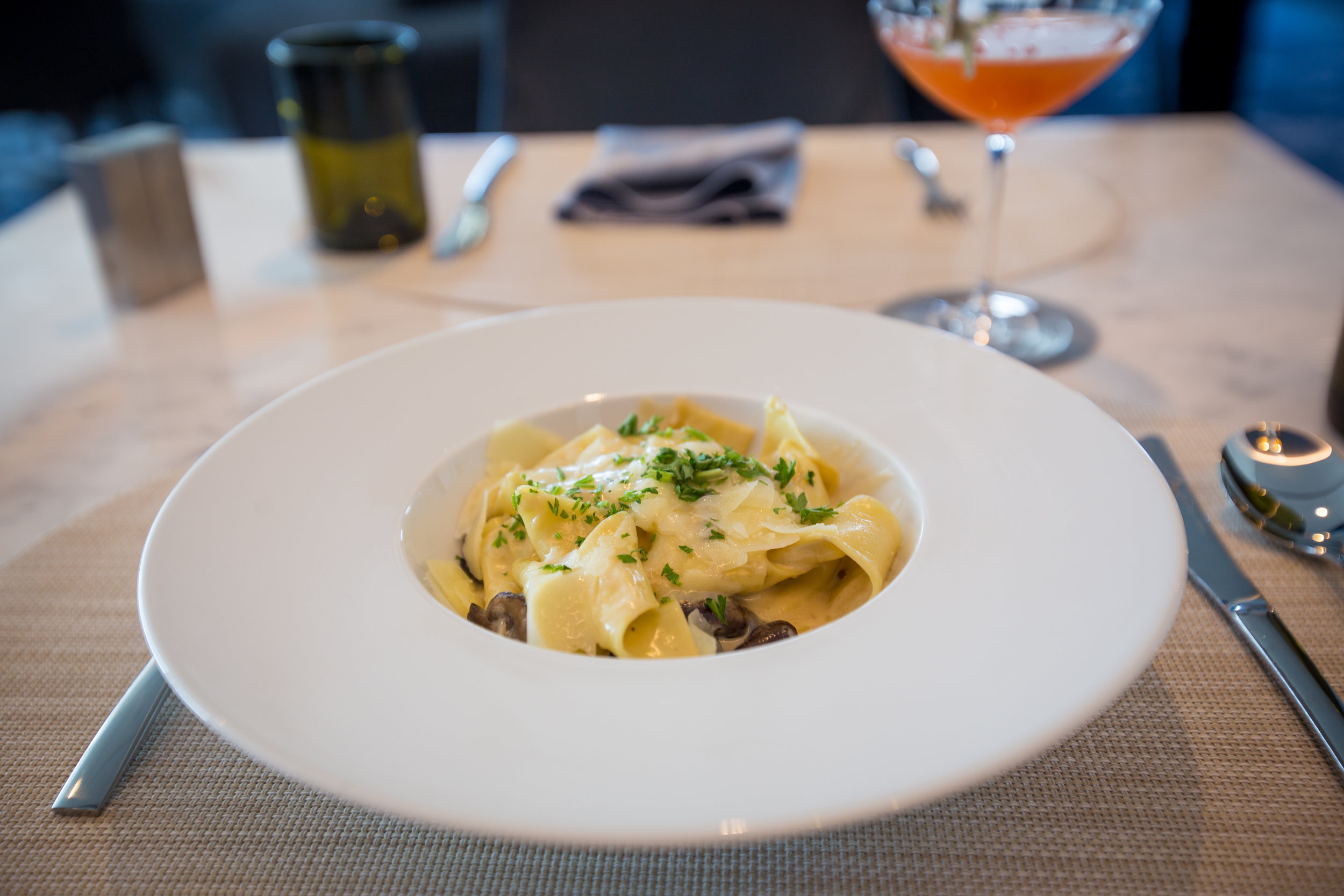 hand-cut pappardelle pasta with mushroom ragout