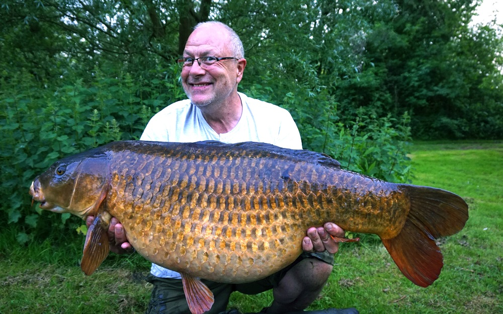 The grin says it all - 44lb 11oz of Oxon common