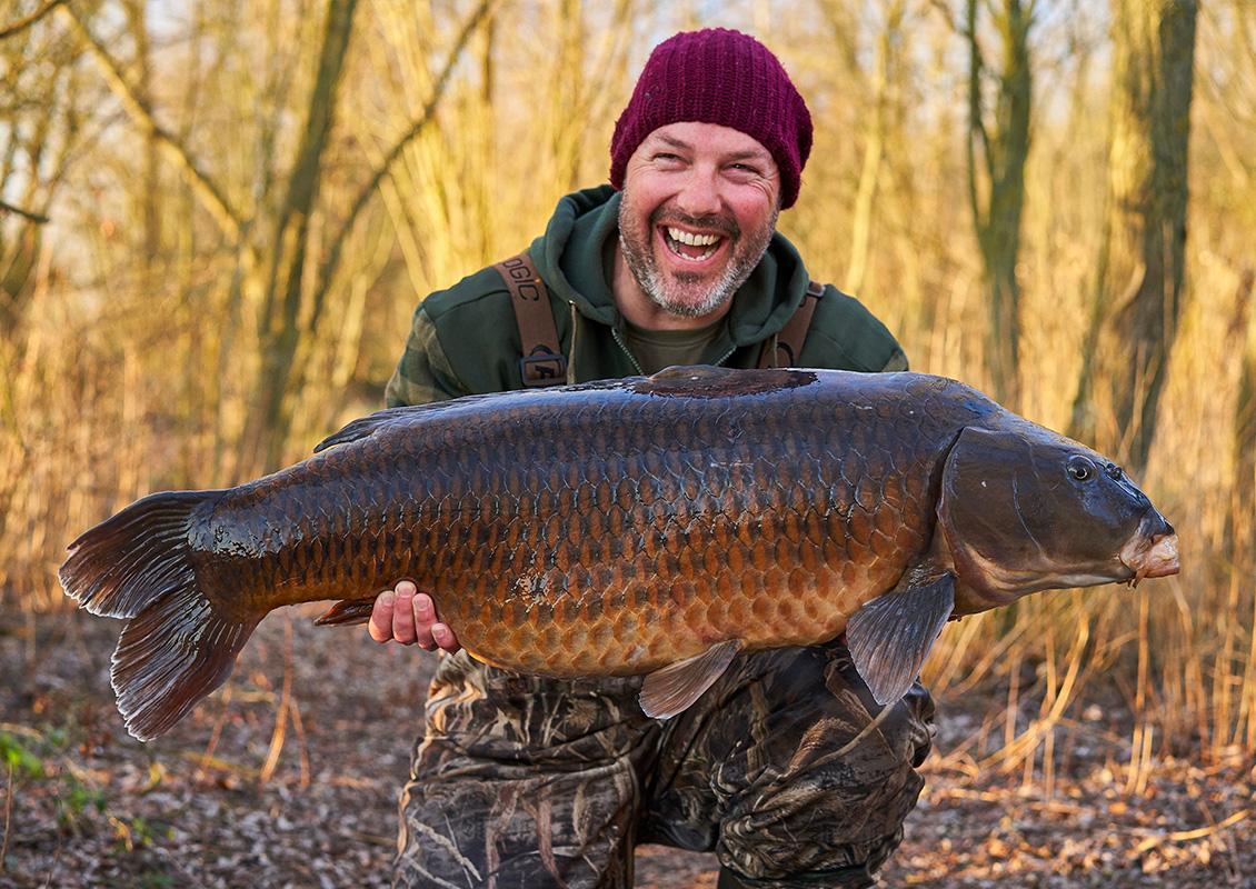 No wonder Adam's smiling. What a fish!