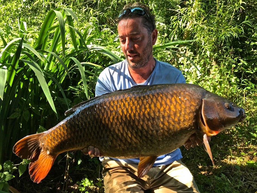 Adam Fisher with a classic Redmire common. Will it ever be fished again?