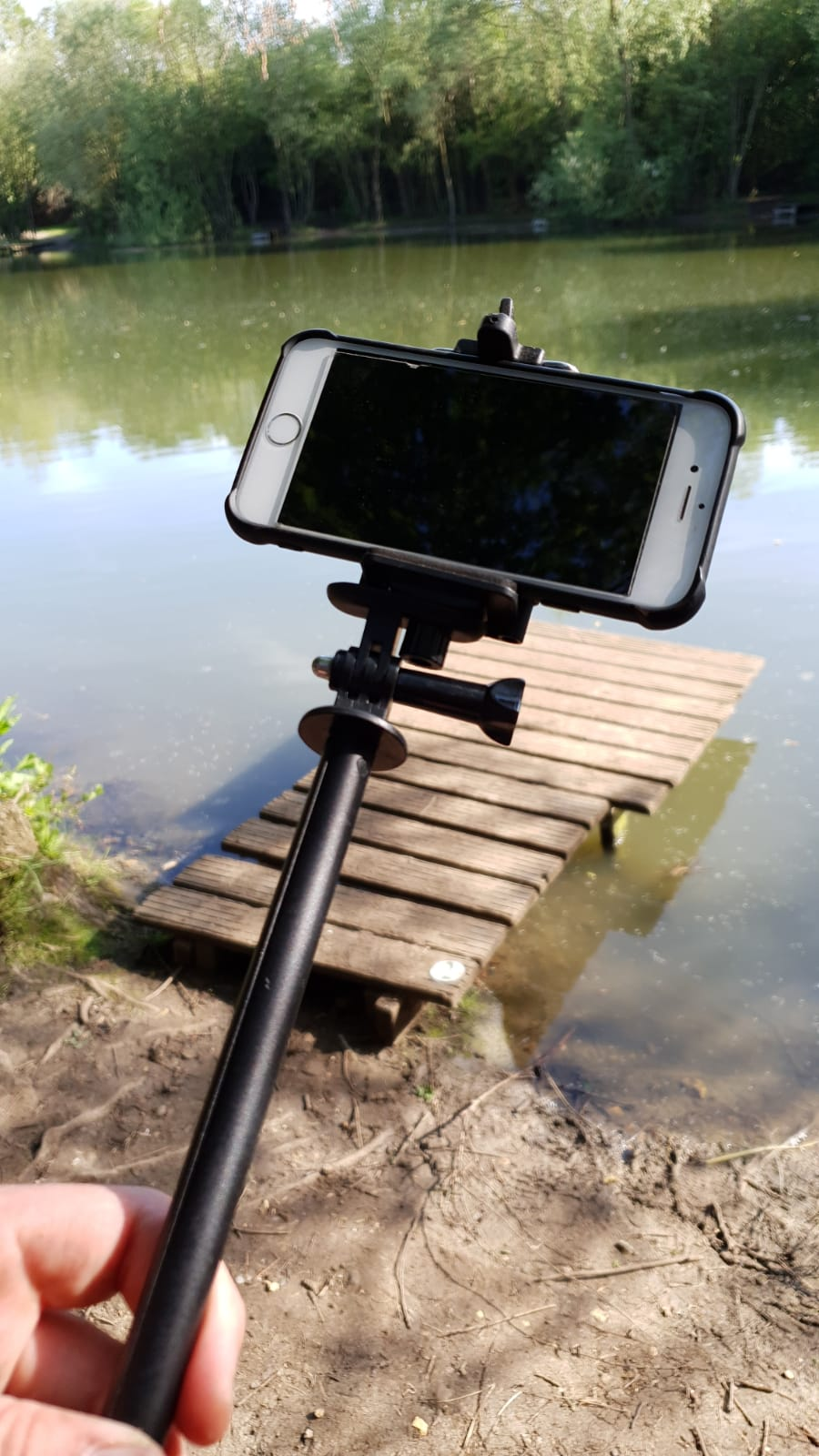 DIY option: a cheap selfie stick wedged into a rucksack or bucket can make do a tripod
