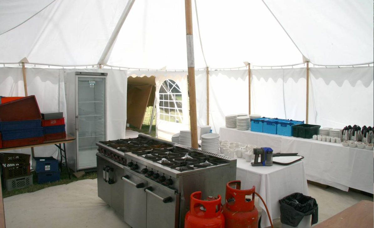 CATERING TENT  Our 6x3m catering tent comes equipped with trestle tables, a washing up station and a range of catering equipment including electric hobs, oven, rice cooker, steamer, deep fryer, sandwich press and all the necessary pans and cooking tools.