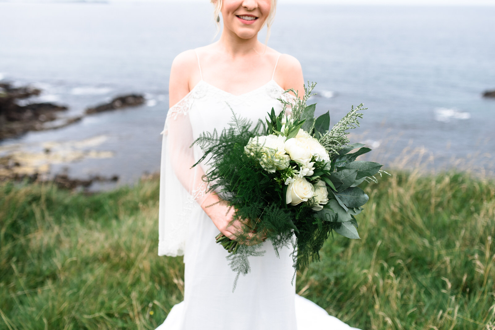 dunluce castle elopement in ireland in sage and white, cliff of northern ireland, green wedding flowers-1.jpg