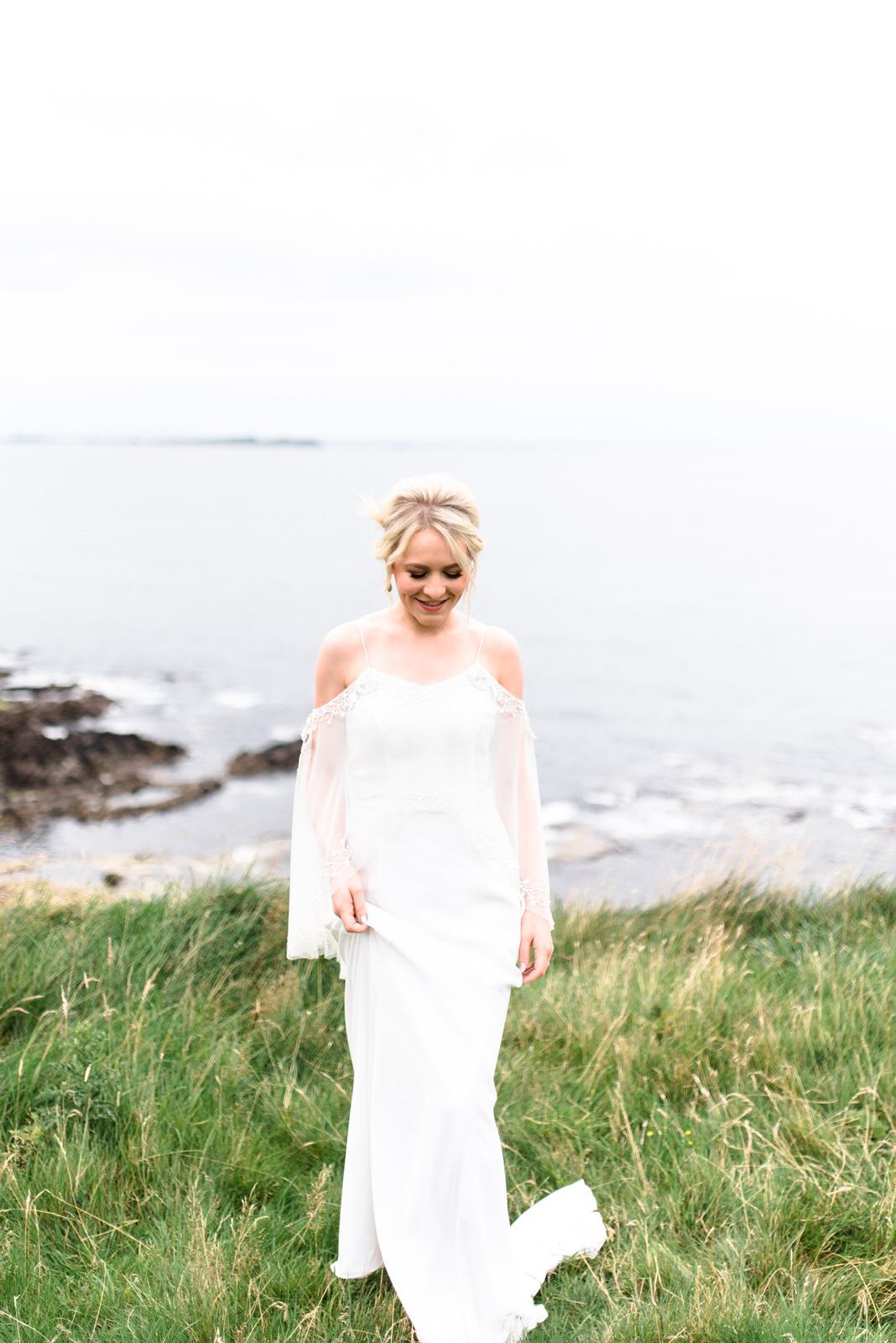 fine art dunluce castle elopement in ireland in sage and white, cliff of northern ireland, bo and luca wedding dress, irish wedding-1.jpg