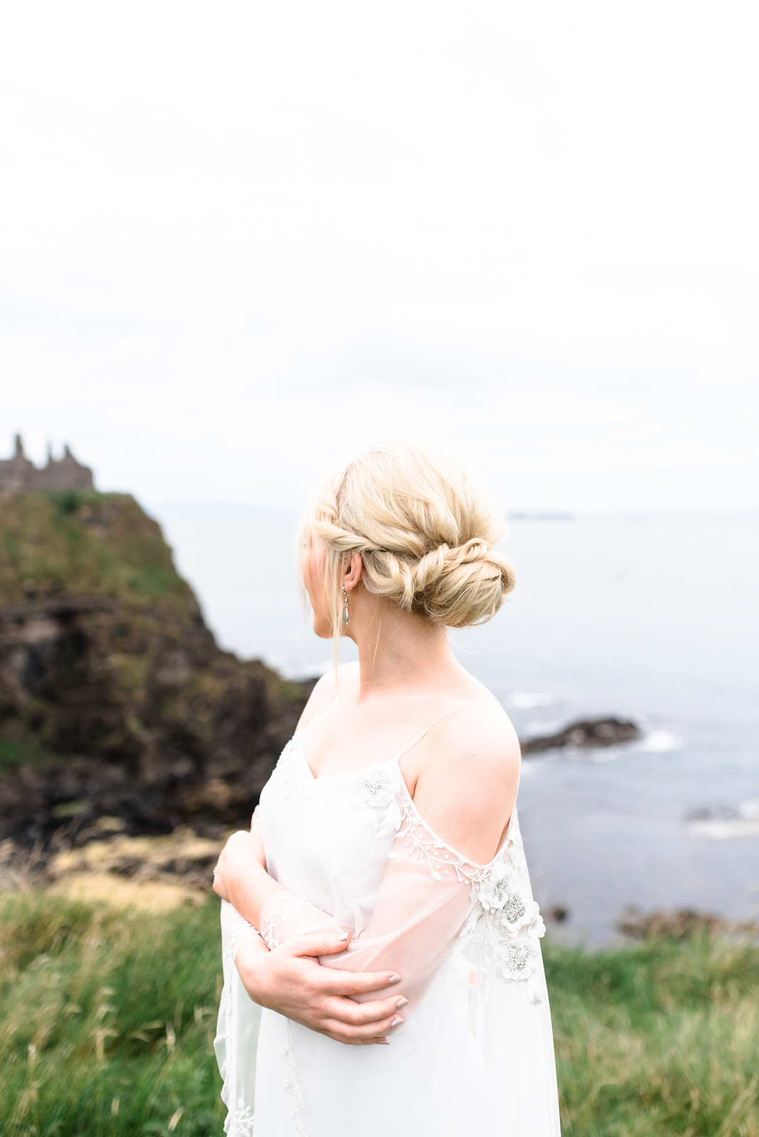 fine art dunluce castle elopement in ireland in sage and white, cliffs of northern ireland, bo and luca wedding dress, wedding hairstyle, blonde hair-1.jpg
