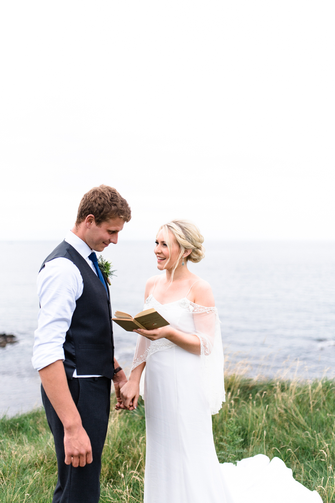 fine art dunluce castle elopement in ireland in sage and white, vows reading on the cliff of northern ireland (2)-1.jpg