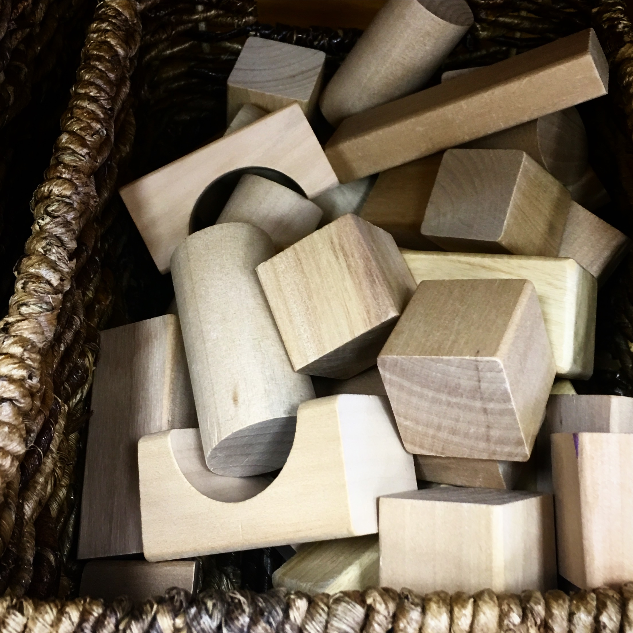 Torah Play rooms are full of natural materials for kids to explore like wooden blocks and silk materials
