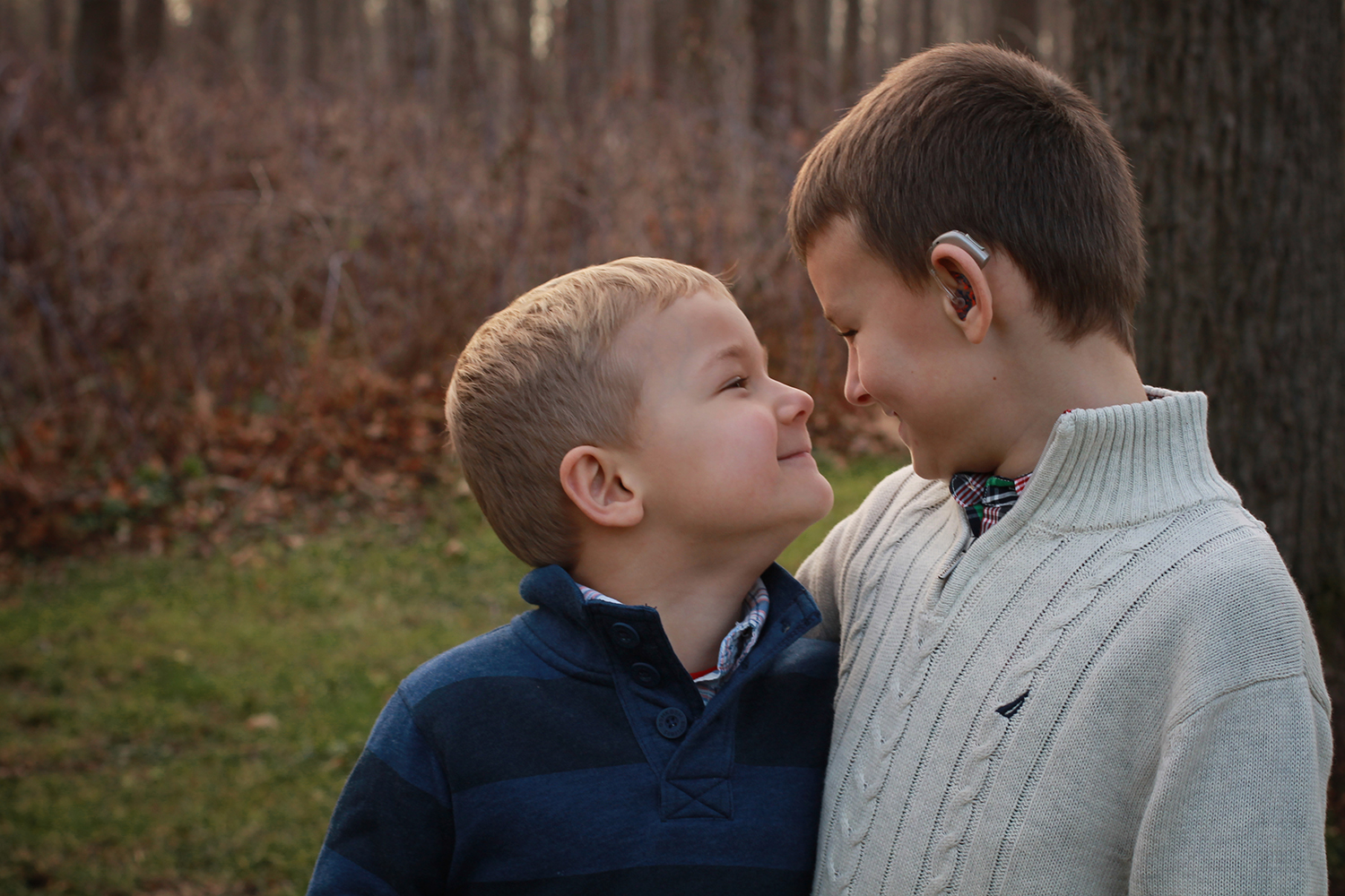 Copy of brothers looking at each other during family photo session