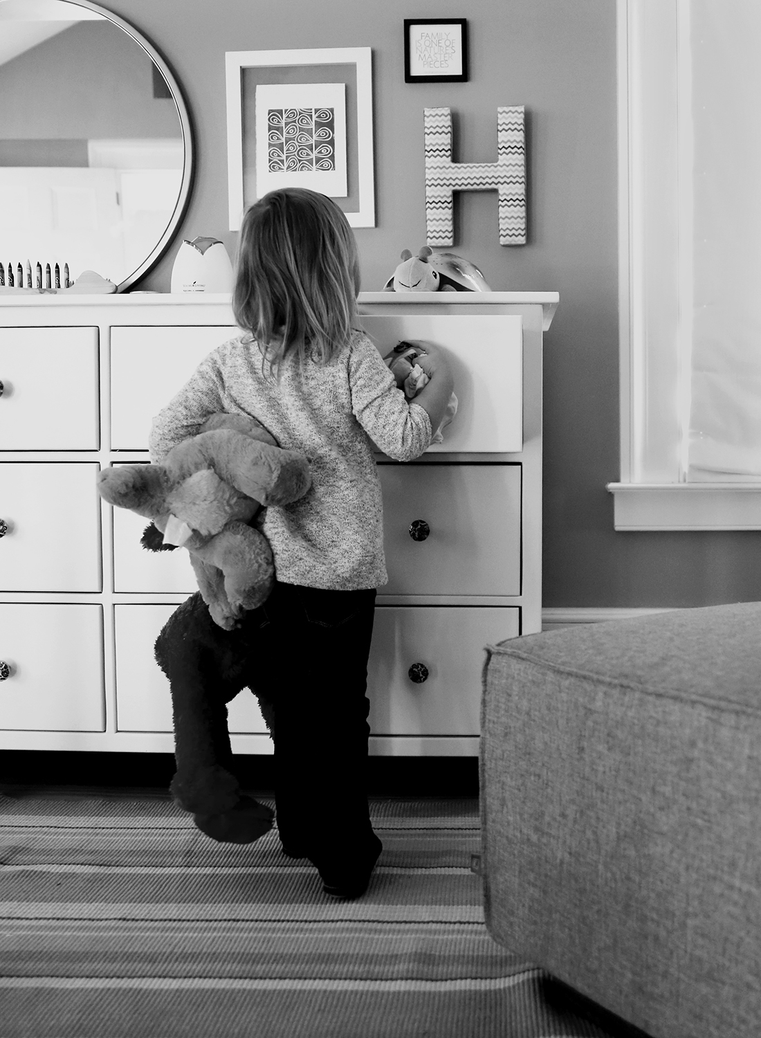 toddler gets clothes out of dresser during lifestyle photo session