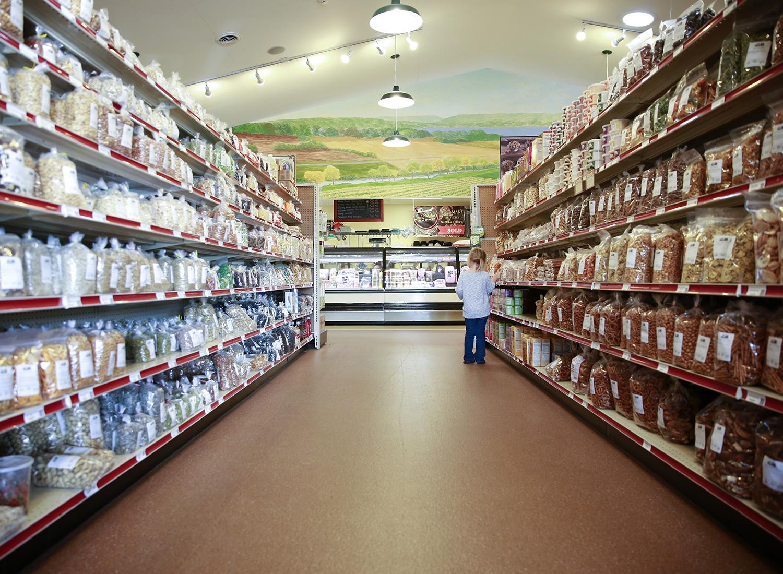 Copy of girl peruses candy aisle in oak hill bulk foods penn yan new york