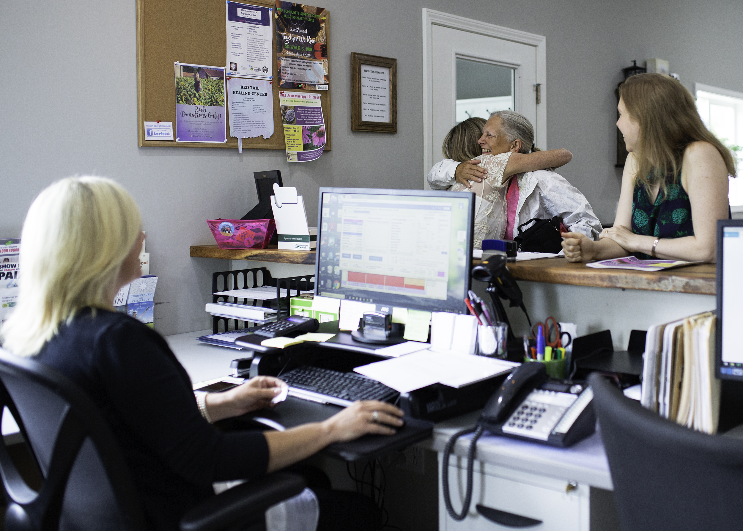 patient-hugs-chiropractor-documentary-business-photographer-canandaigua-new-york-erin-cunningham.jpg