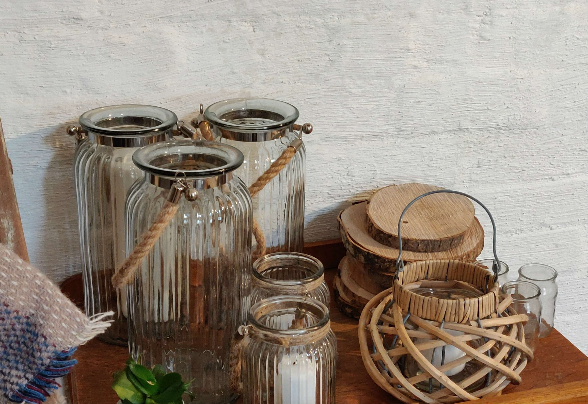 Glass Lanterns/Vases - Large Hire £4 each; Medium Hire £2.50 each //  Wicker lantern Hire £2.50 each // Log rounds - various sizes Hire from £1