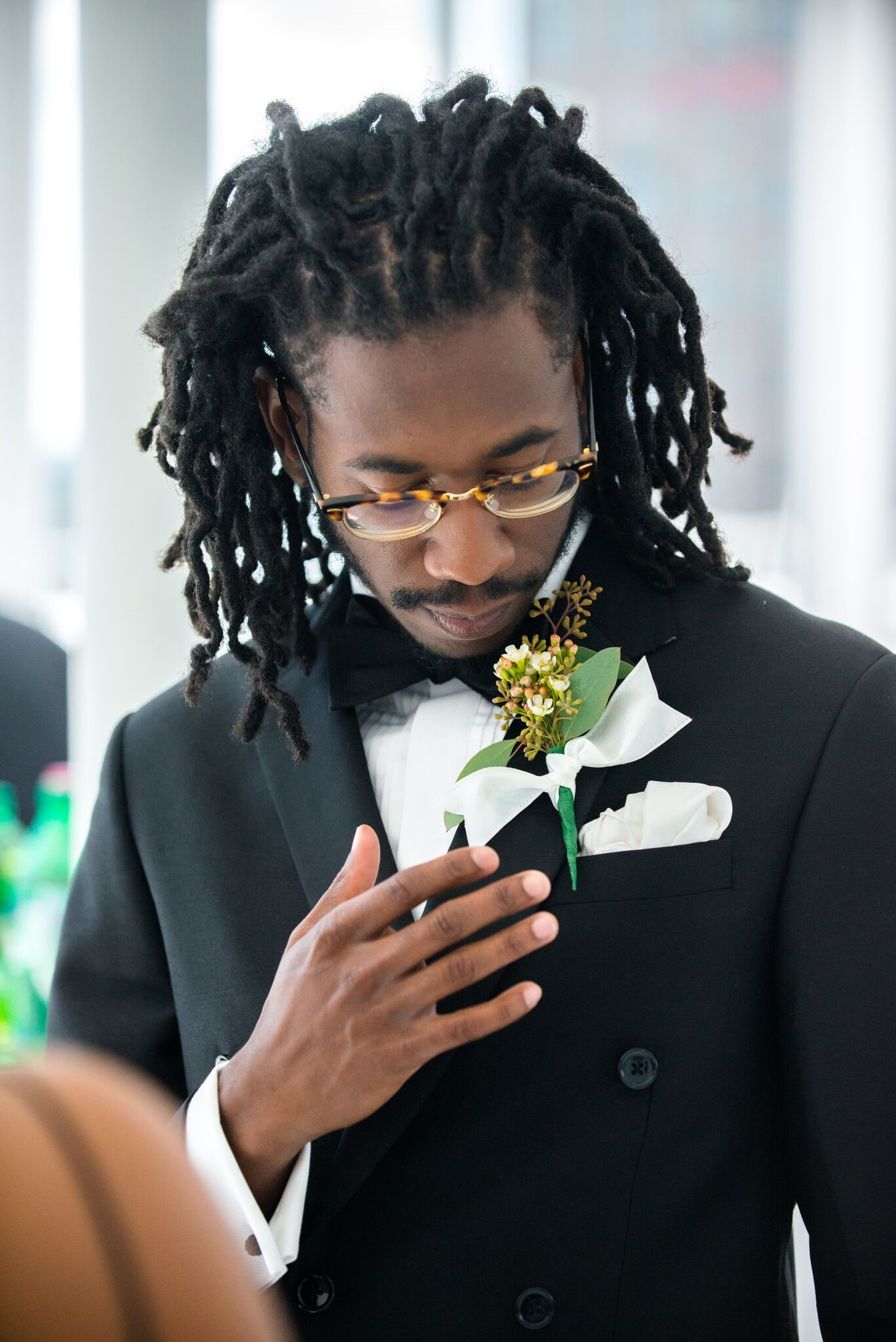 Olive leaf boutonniere by Heights Florist
