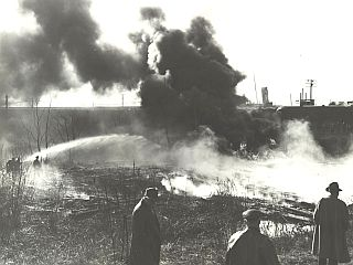 1951: Oil Burning in the Cuyahoga River, located in the downtown Cleveland Flats area.