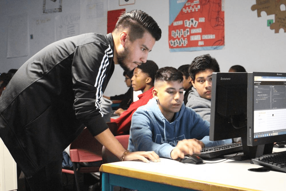 Luis Rocha at an Hour of Code event, where he taught freshman at a local high school the basics of code and the tech industry.