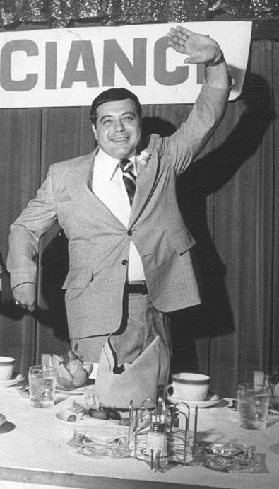 Buddy makes his way to the head of the table at his victory celebration. Providence Journal file photo/Richard Benjamin .