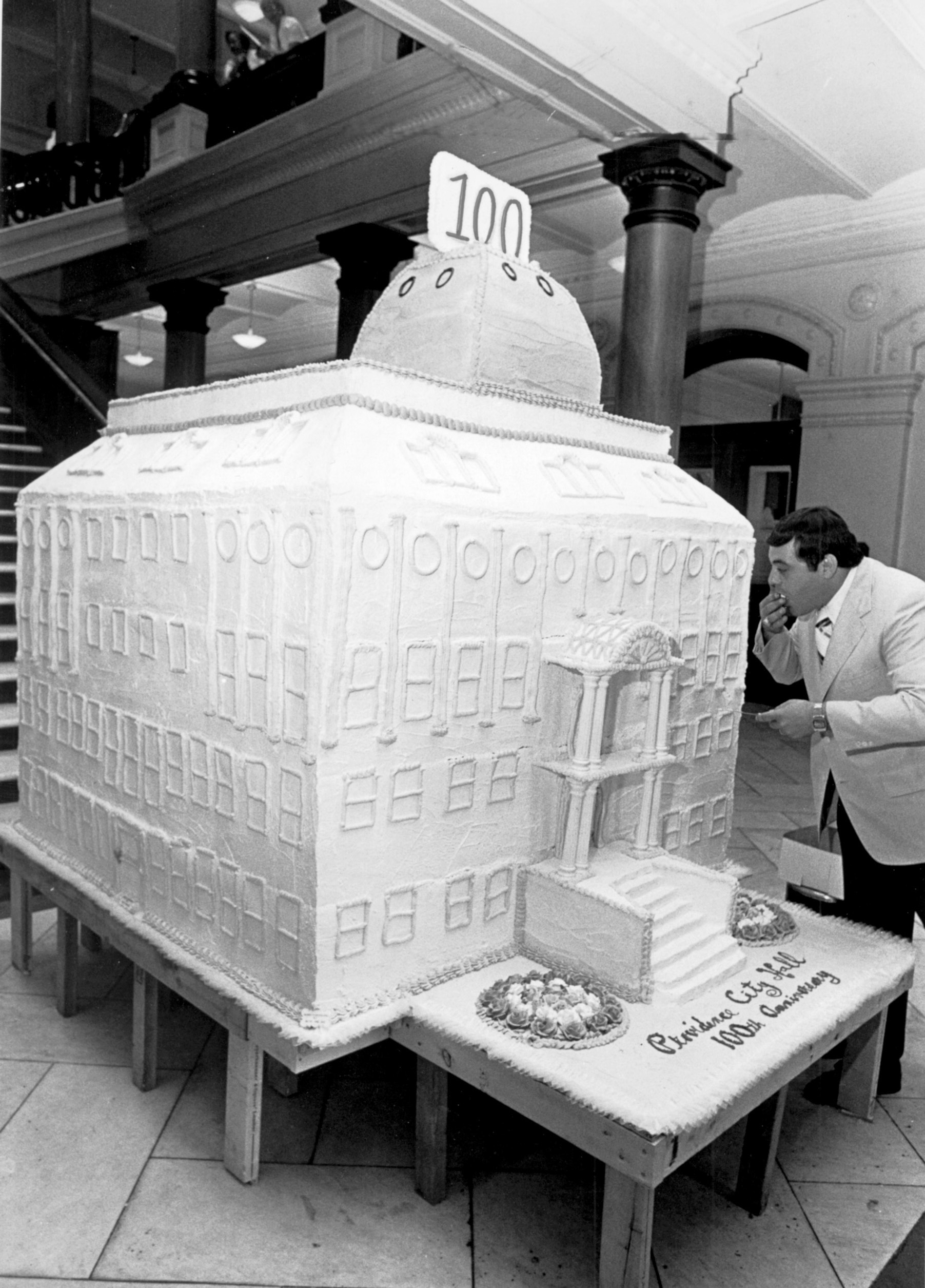 In 1975, Buddy samples a cake made in the shape of City Hall, for the city of Providence's 100th birthday.  Providence Journal file photo.