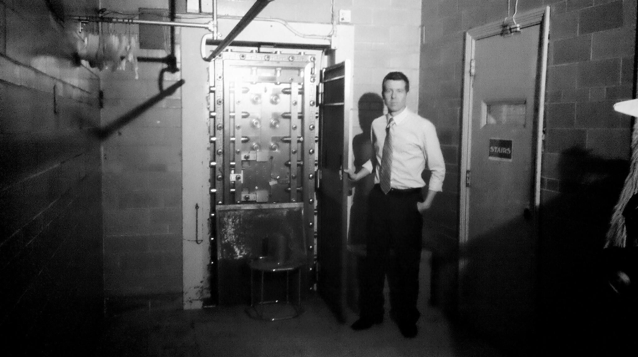 Reporter Tim White next to the door of the Bonded Vault.  Courtesy of John Villella/WPRI-TV.
