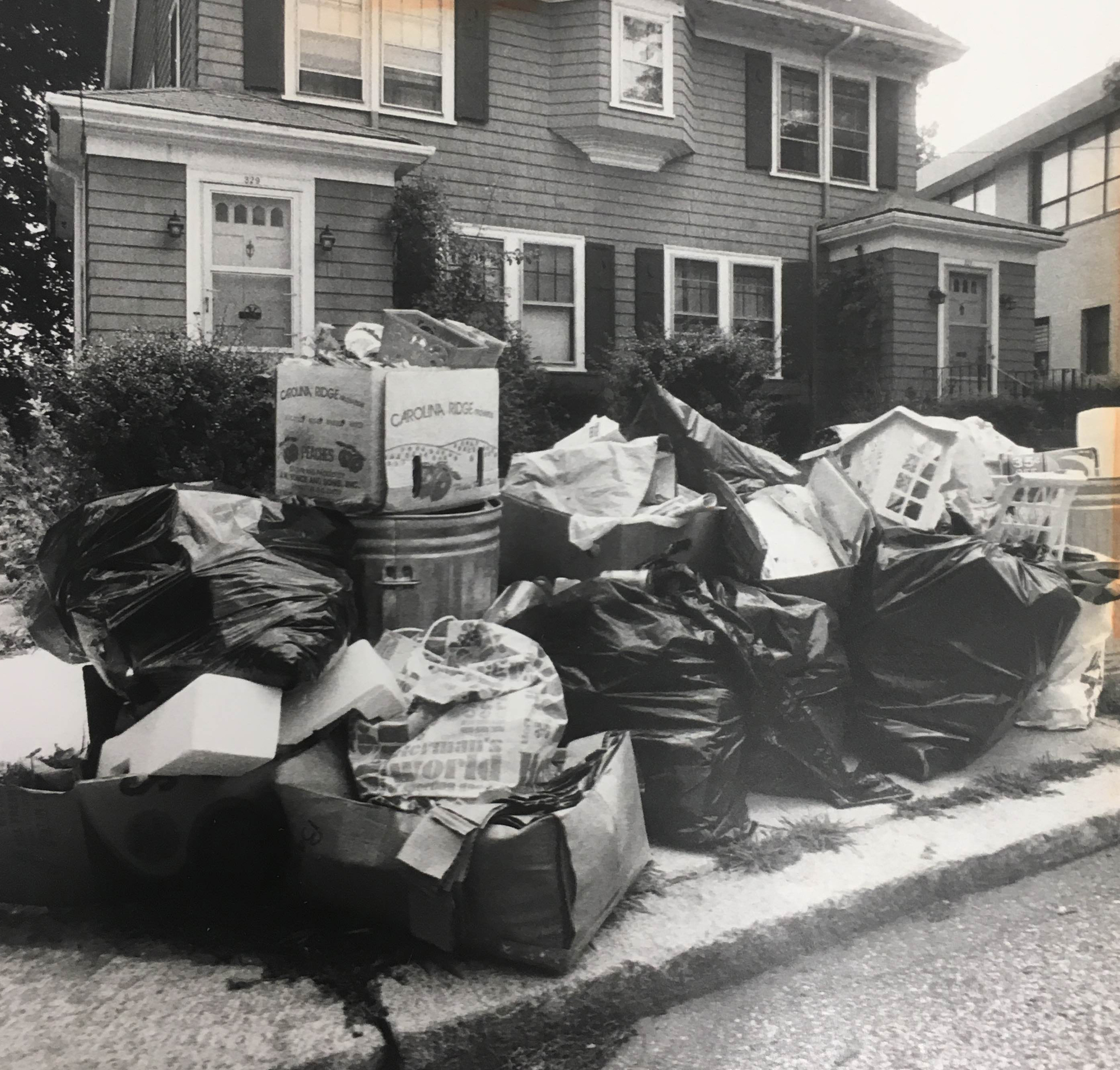 Piles of trash rot in the summer sun on the streets of Providence. After Buddy threatened layoffs and cutbacks, garbage workers went on strike.  Courtesy of the Providence Journal.