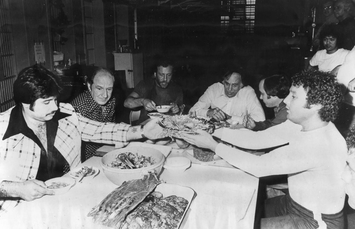 George Basmajian , far left, enjoys a lavish meal at  the Adult Correctional Institutions with other wiseguys in the early 1970s.  Courtesy of the Providence Journal.